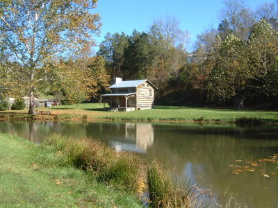 Log House across Pond